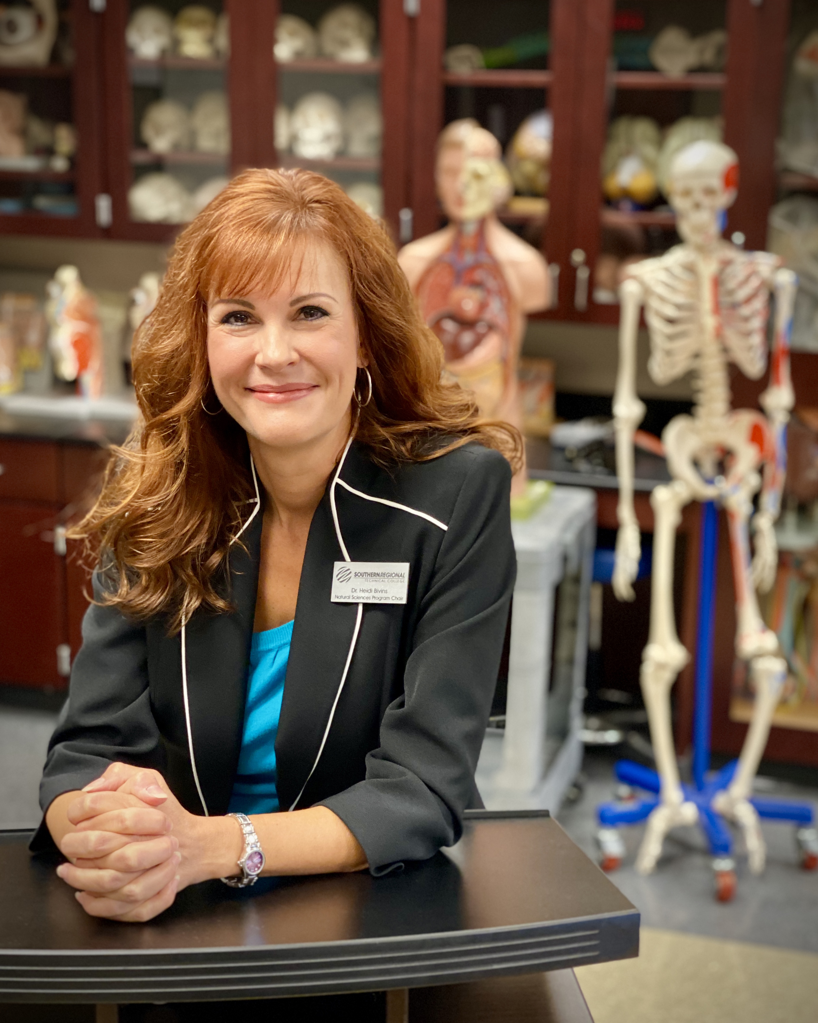 female professor in anatomy lab setting