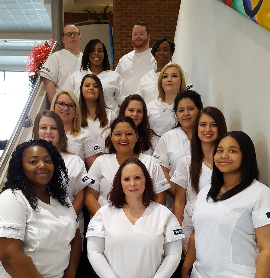 group of practical nursing students on stairs